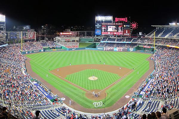 Nationals baseball stadium at night with a big crowd