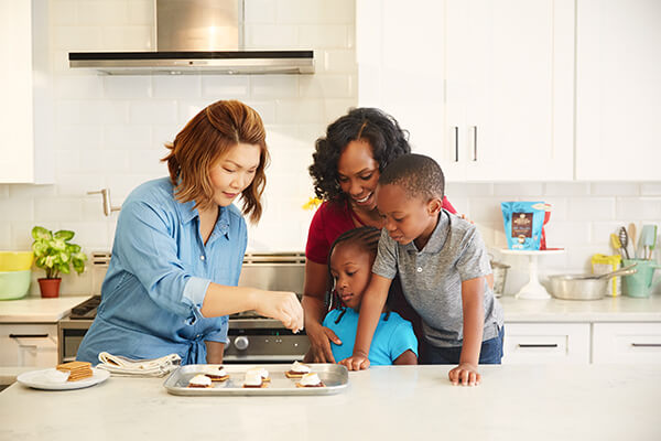 food stylist Julia Choi with an african american family making s'mores with american heritage chocolate